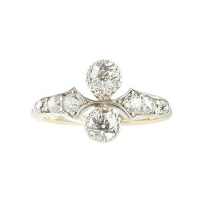 Lot 104 - A two stone diamond ring