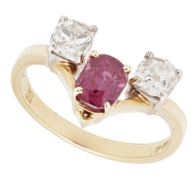 Lot 31 - A ruby and diamond set three stone ring