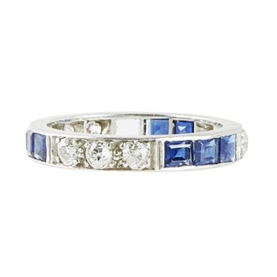 Lot 72 - A sapphire and diamond set eternity ring