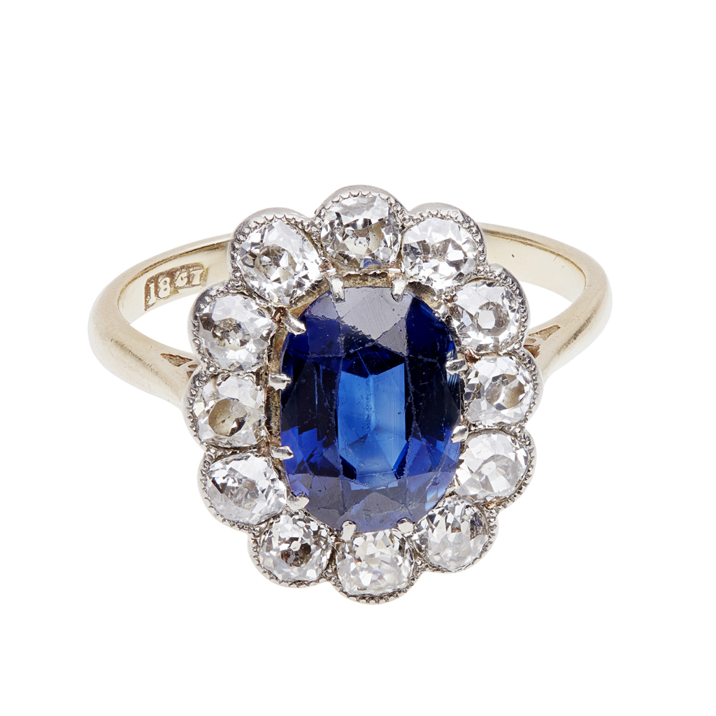 Lot 71 - A sapphire and diamond set cluster ring