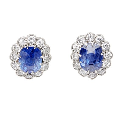 Lot 70 - A pair of sapphire and diamond set cluster earrings
