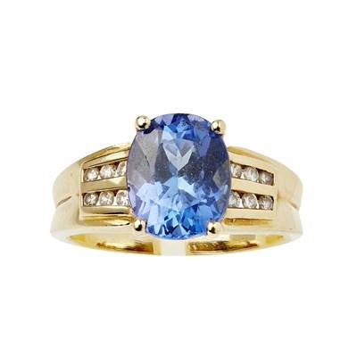 Lot 65 - A contemporary Tanzanite and diamond set ring