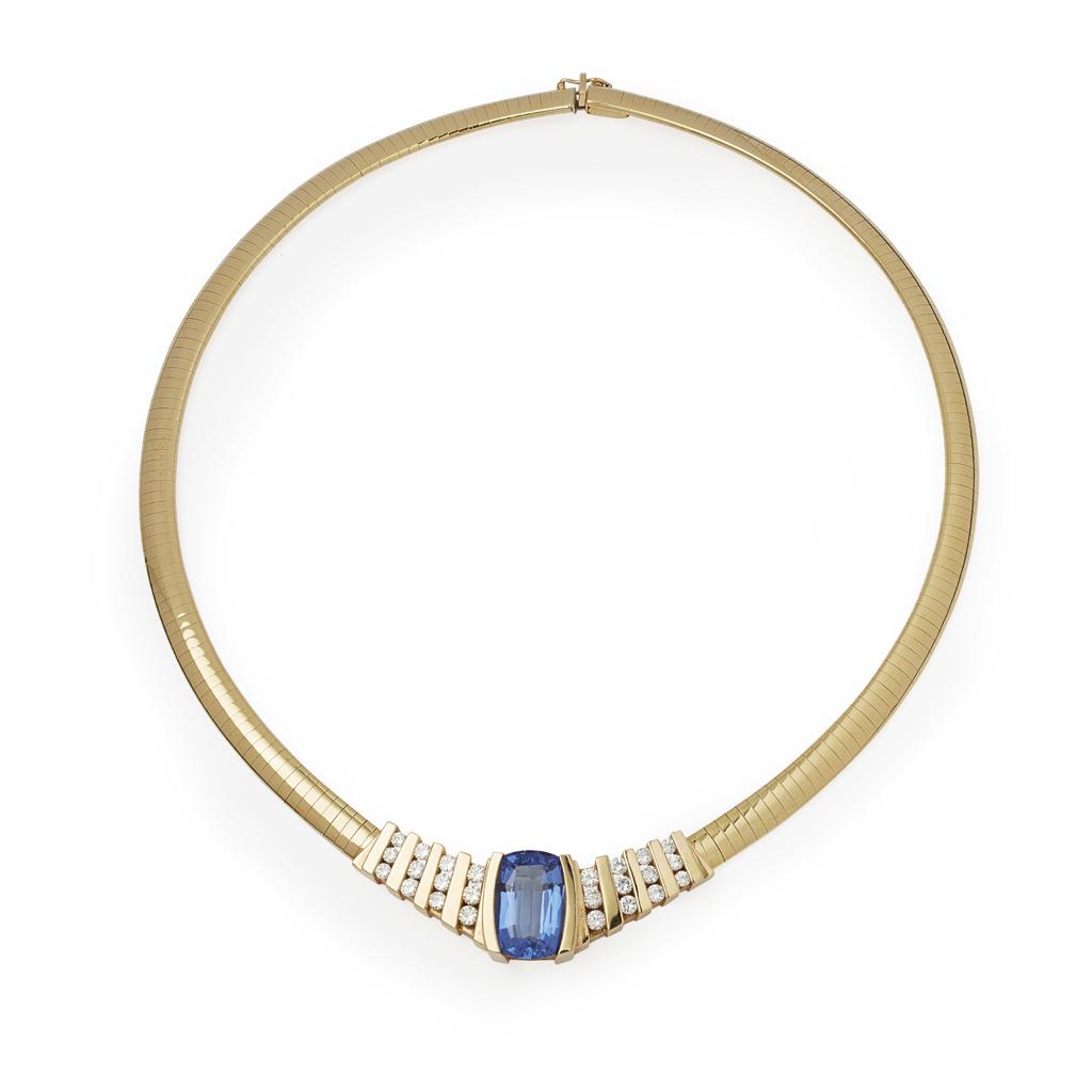 Lot 63 - A contemporary Tanzanite and diamond set necklace
