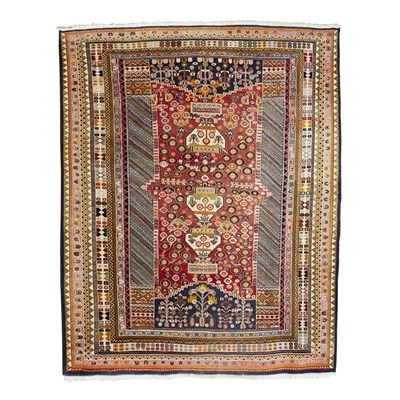Lot 75 - PERSIAN CARPET MODERN the red field with urn...