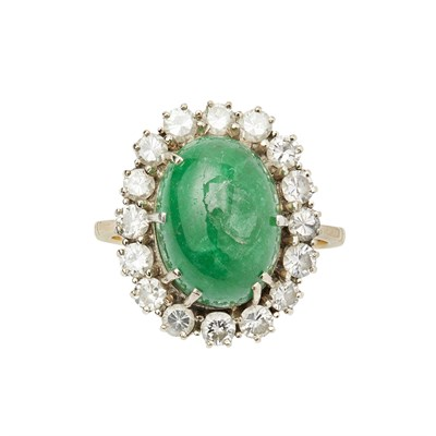 Lot 21 - An emerald and diamond set cluster ring