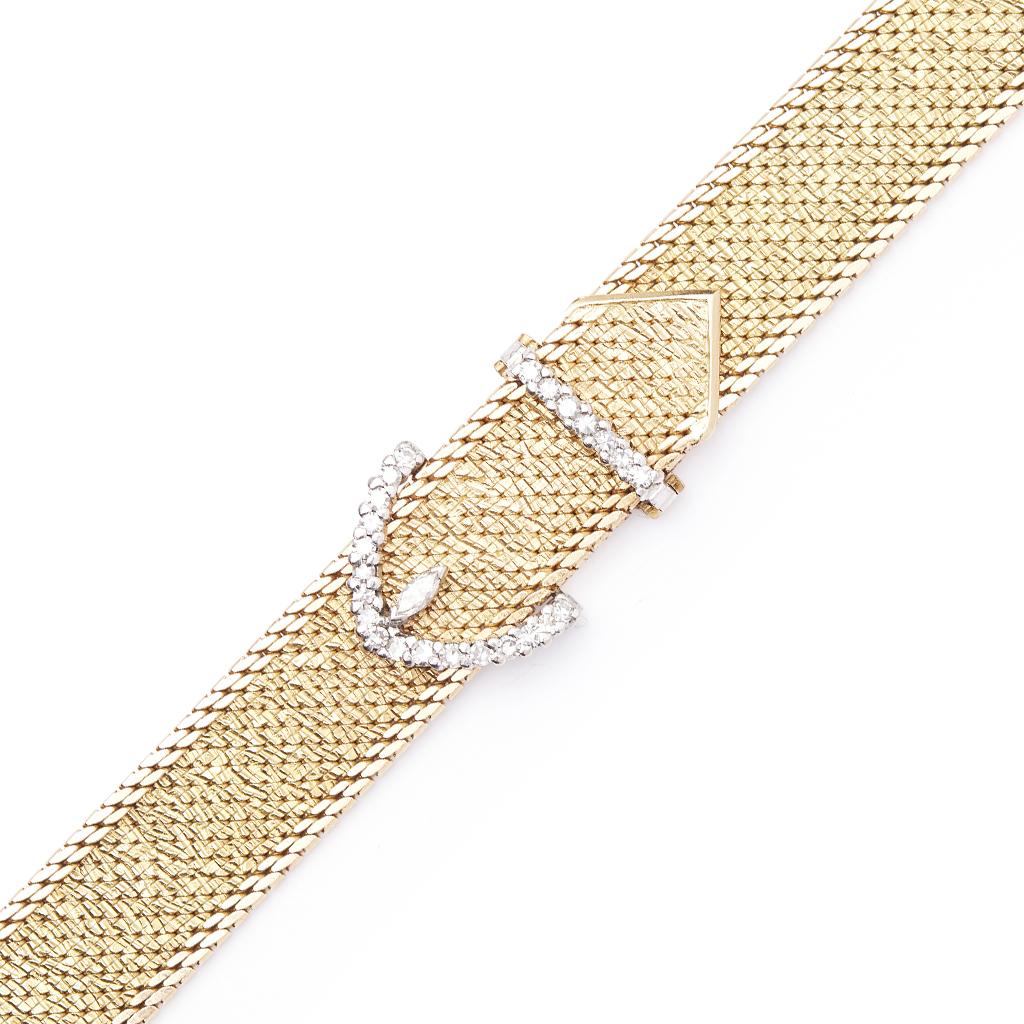 Lot 74 - An 18ct gold and diamond set bracelet