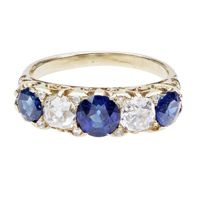 Lot 129 - A five stone sapphire and diamond set ring