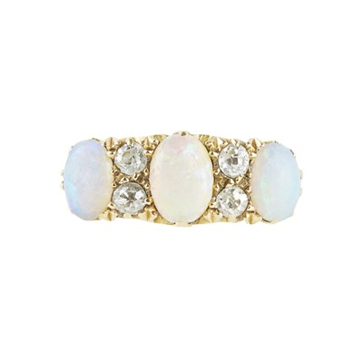 Lot 134 - A 18ct gold diamond and opal set ring