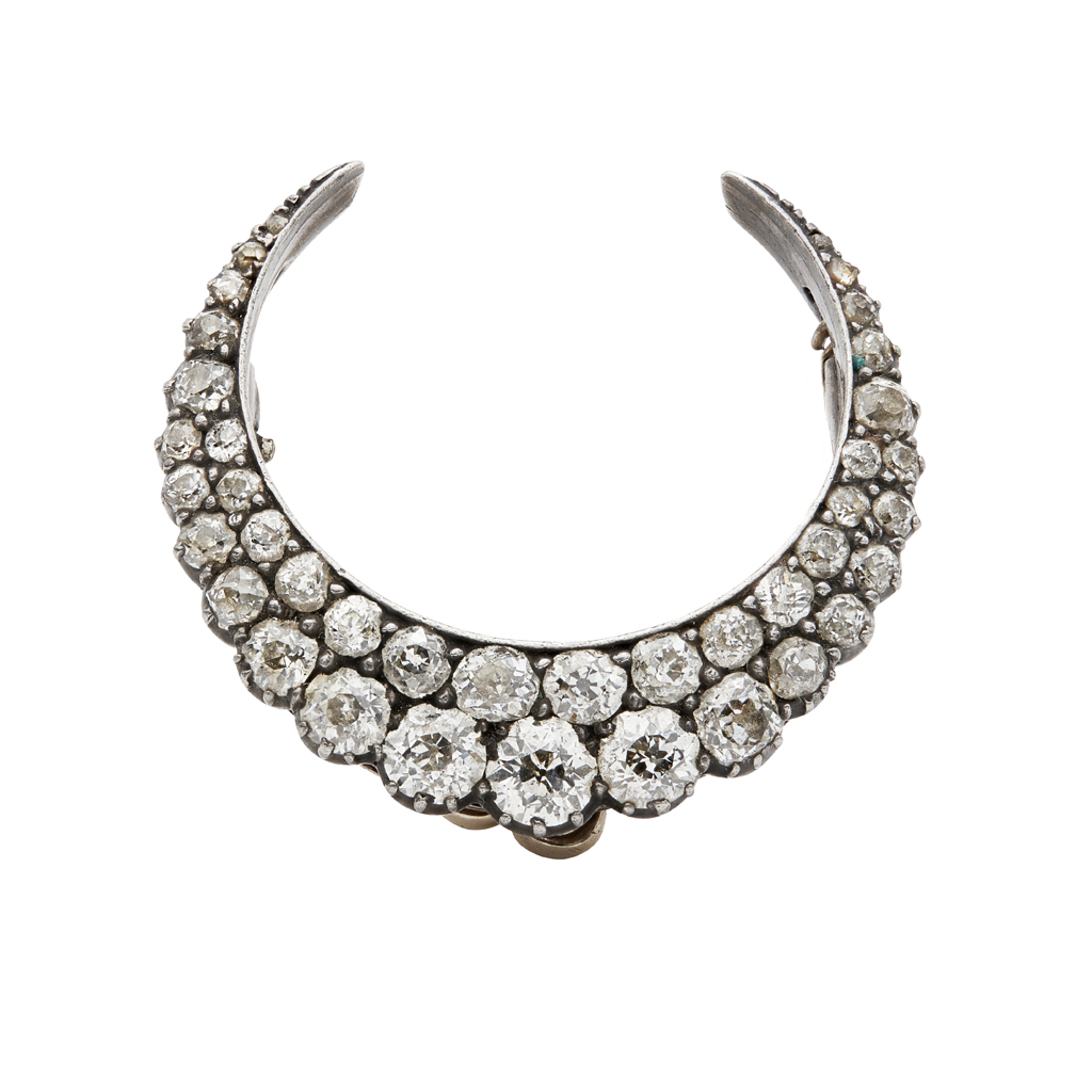 Lot 58 - A Victorian diamond set crescent brooch