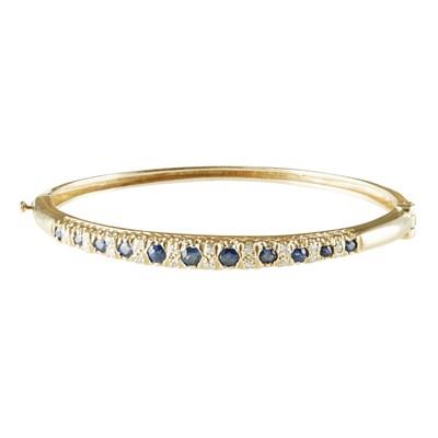 Lot 32 - A sapphire and diamond set bangle