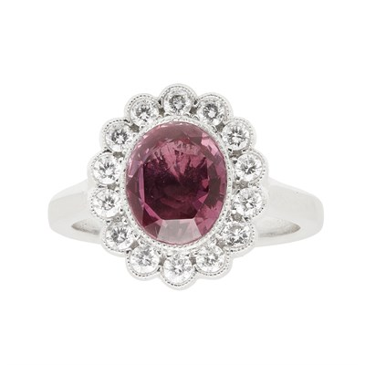 Lot 62 - A ruby and diamond cluster ring