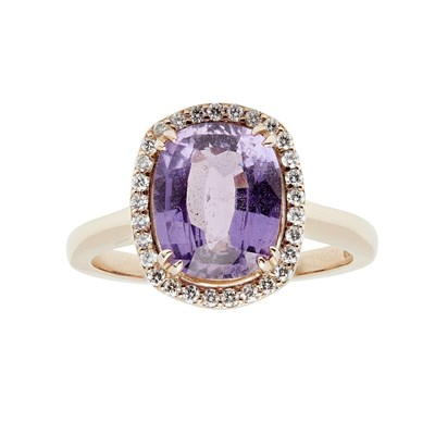 Lot 61 - A purple colour-change sapphire and diamond cluster ring