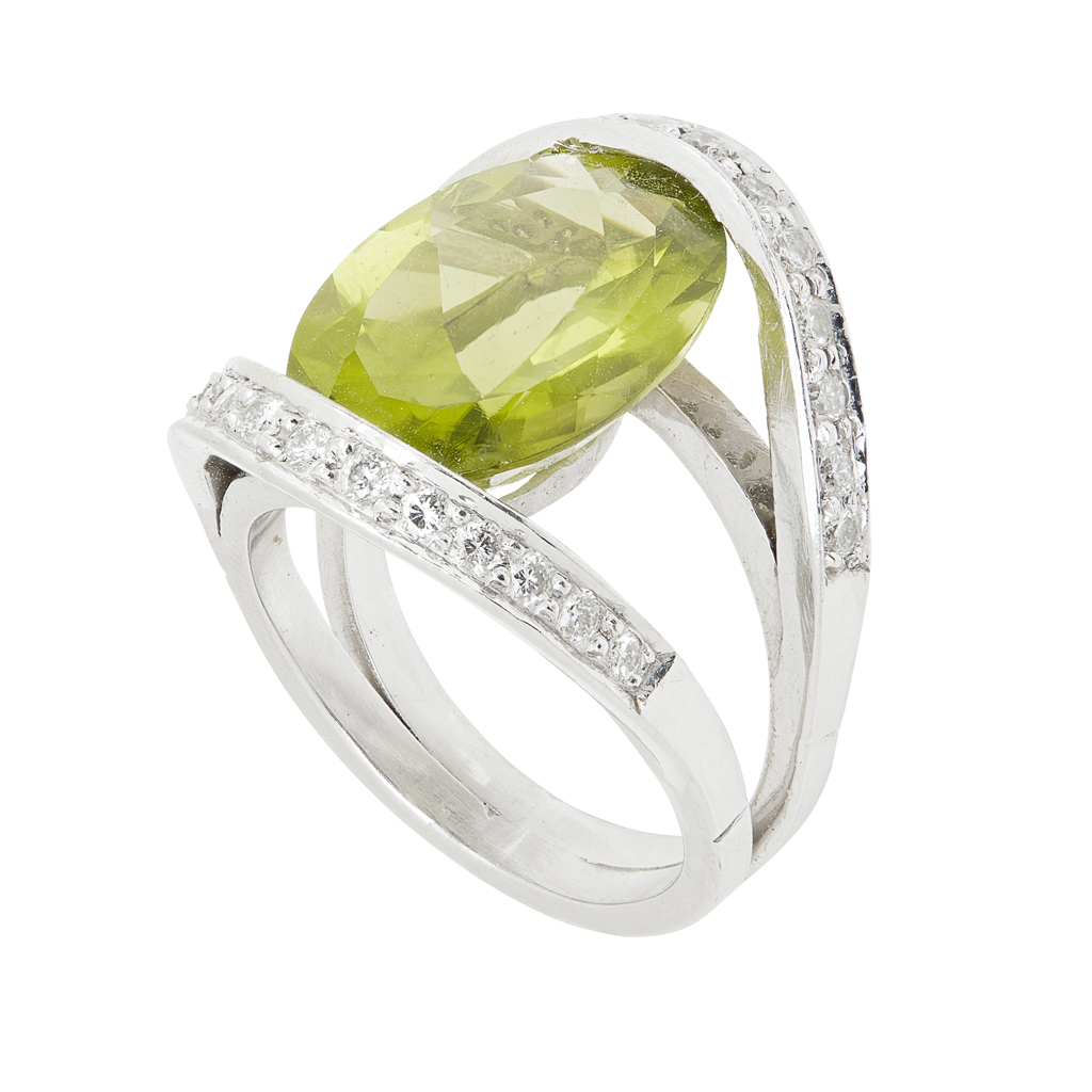 Lot 66-A peridot and diamond set cluster ring