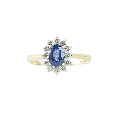 Lot 29 - A sapphire and diamond set cluster ring