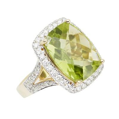 Lot 60 - A peridot and diamond set cluster ring
