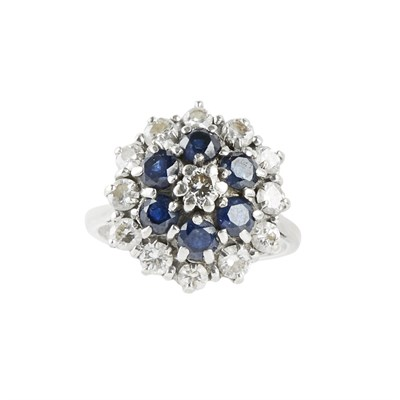 Lot 75 - A sapphire and diamond set cluster ring