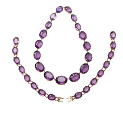 Lot 33 - An amethyst set necklace and matching bracelets