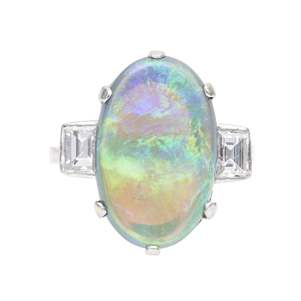Lot 131 - An opal and diamond set ring