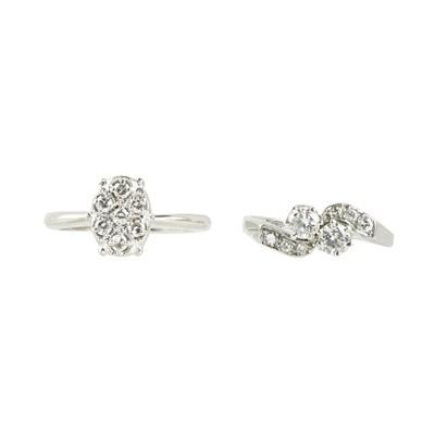Lot 19-A two-stone diamond set twist ring