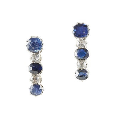 Lot 73 - A pair of sapphire set pendant earrings