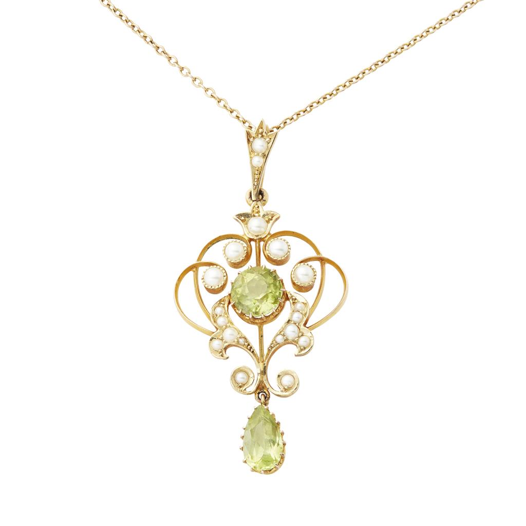 Lot 1-An Edwardian peridot and seed pearl set pendant