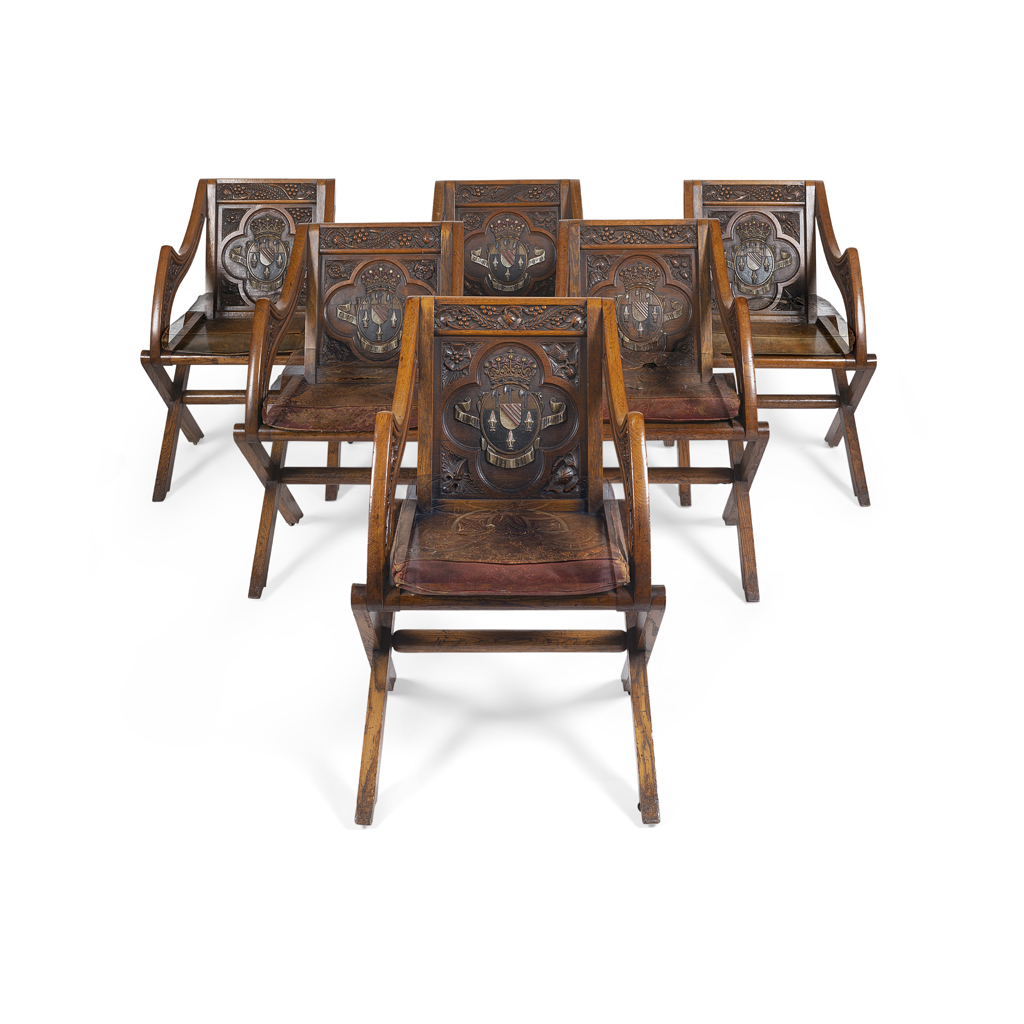 Lot 164-SET OF EIGHT EARLY VICTORIAN OAK AND POLYCHROME HERALDIC 'GLASTONBURY' CHAIRS, BEARING THE LOVELACE COAT-OF-ARMS