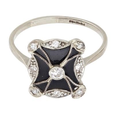 Lot 76-An Edwardian onyx and diamond set ring