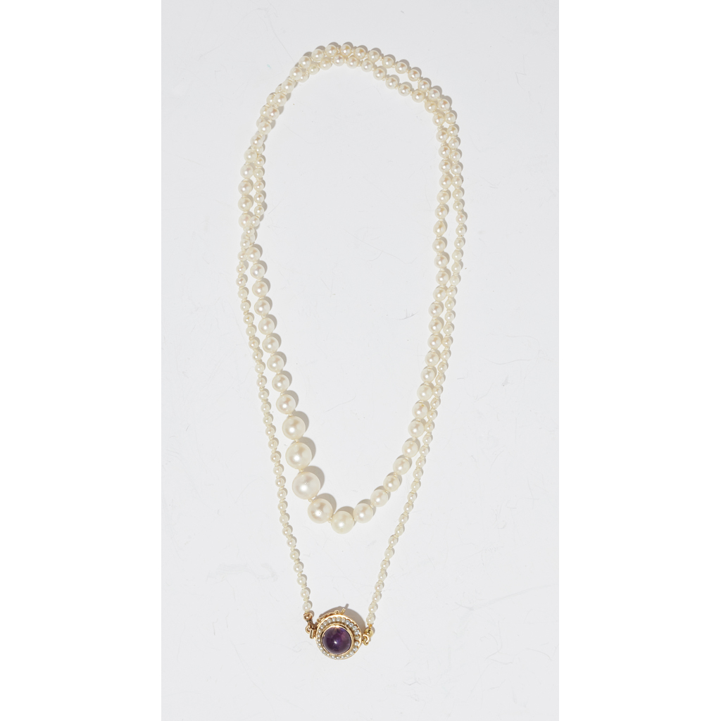 Lot 59-A pearl and amethyst set necklace