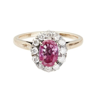 Lot 24-A pink sapphire and diamond set ring