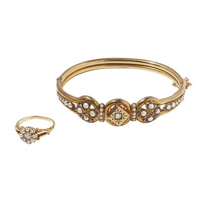 Lot 16-An Edwardian diamond and pearl set bangle