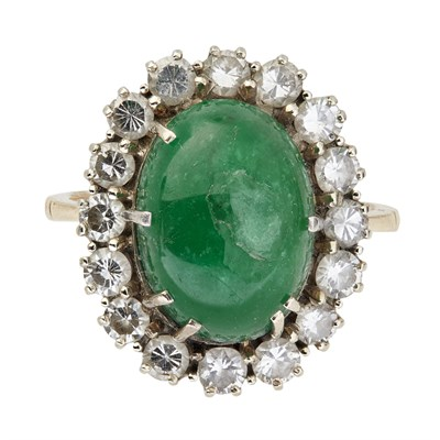 Lot 78-An emerald and diamond set cluster ring
