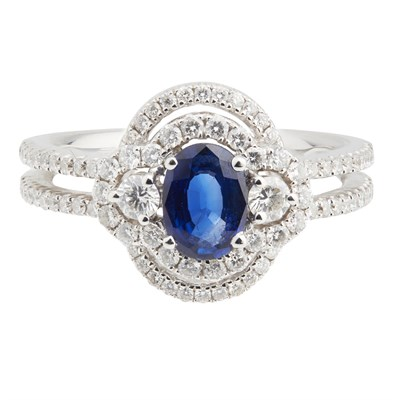 Lot 67-An 18ct white gold sapphire and diamond set cluster ring