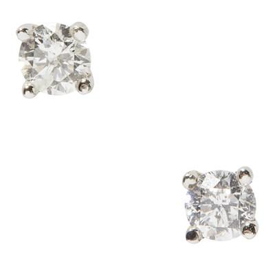 Lot 81-A pair of diamond set stud earrings