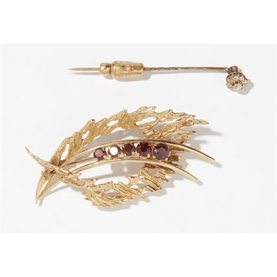 Lot 23-A 9ct gold and garnet set brooch