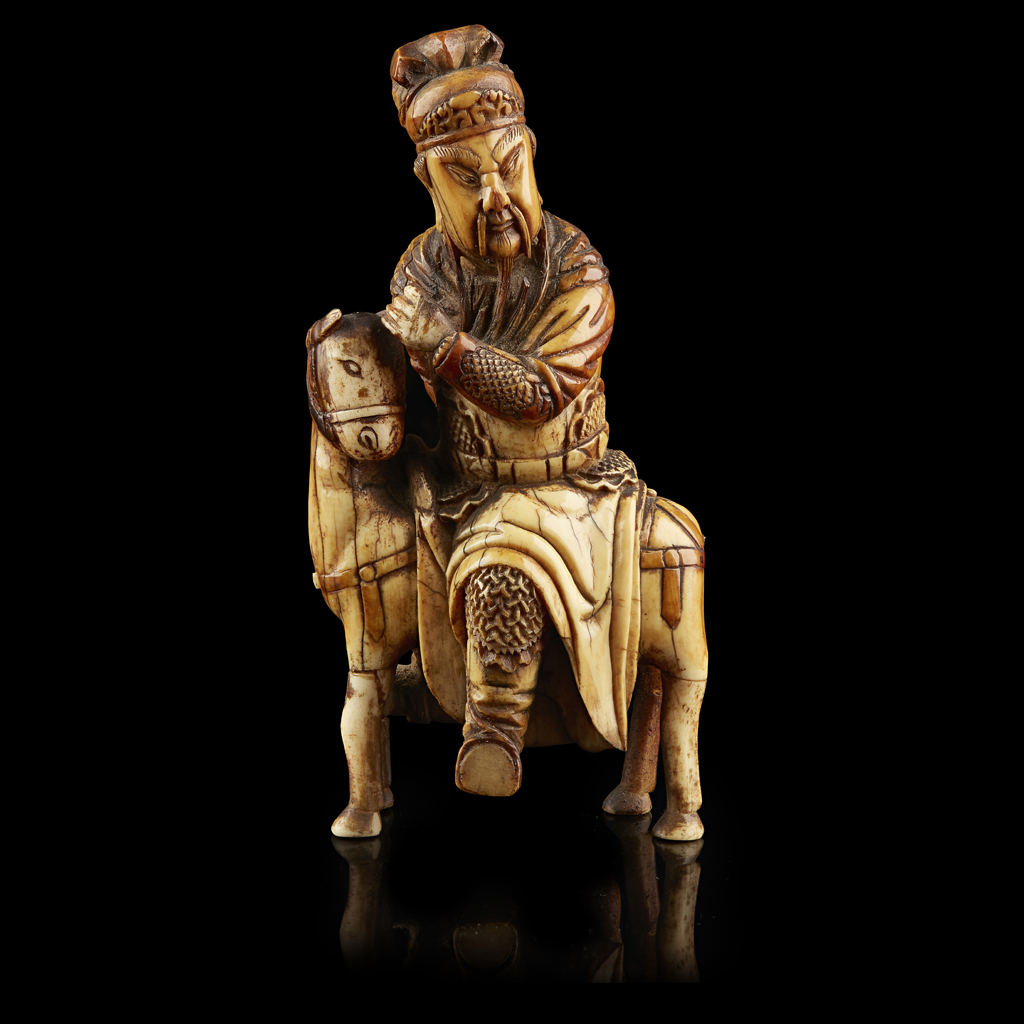 Lot 31-CARVED IVORY EQUESTRIAN FIGURE OF GUANDI