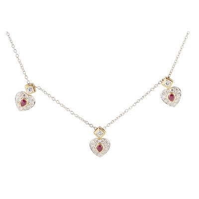 Lot 55-A ruby and diamond set cluster pendant