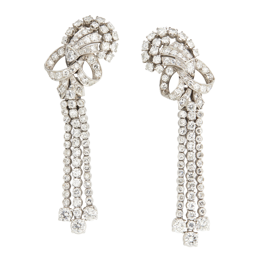 Lot 30-A pair of mid-20th century French diamond set 'night and day' earrings