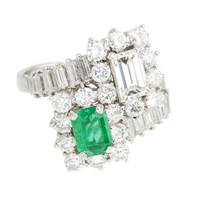 Lot 65-An emerald and diamond set ring