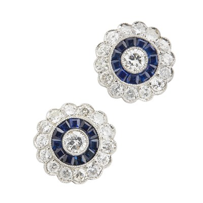 Lot 69-A pair of diamond and sapphire set cluster earrings
