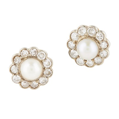 Lot 58-A pair of pearl and diamond set cluster earrings