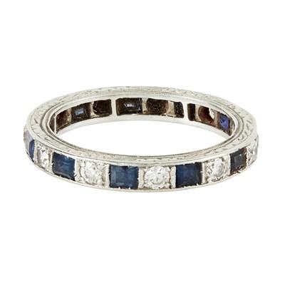 Lot 33-A sapphire and diamond set eternity ring