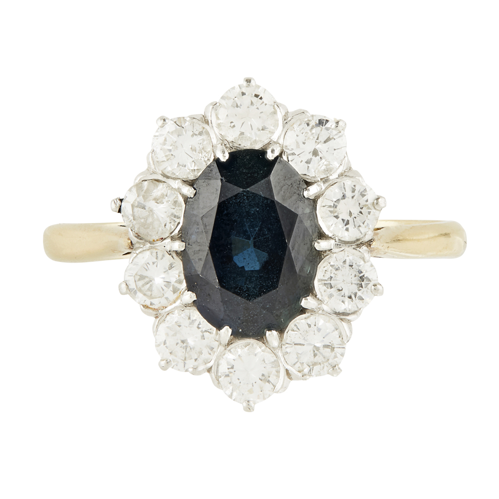 Lot 32-A sapphire and diamond set cluster ring