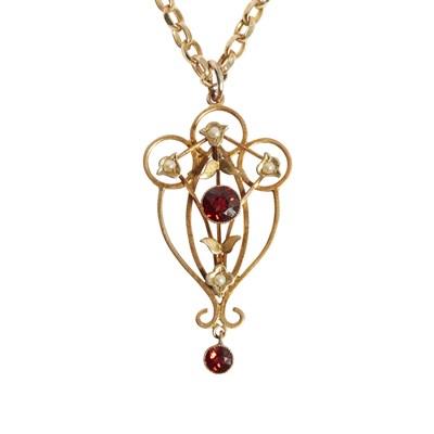 Lot 13-An Edwardian garnet and seed pearl set pendant