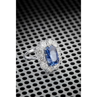 Lot 65-A large sapphire and diamond set cluster ring