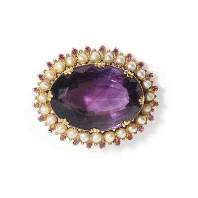 Lot 8-A large amethyst and pearl set brooch