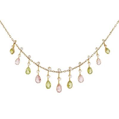 Lot 42-An Edwardian peridot and tourmaline set fringe necklace