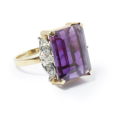 Lot 26-An amethyst set cocktail ring
