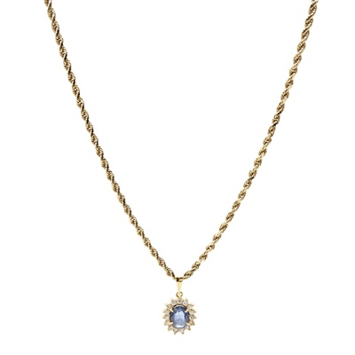 Lot 12-A sapphire and diamond set pendant and matching earrings