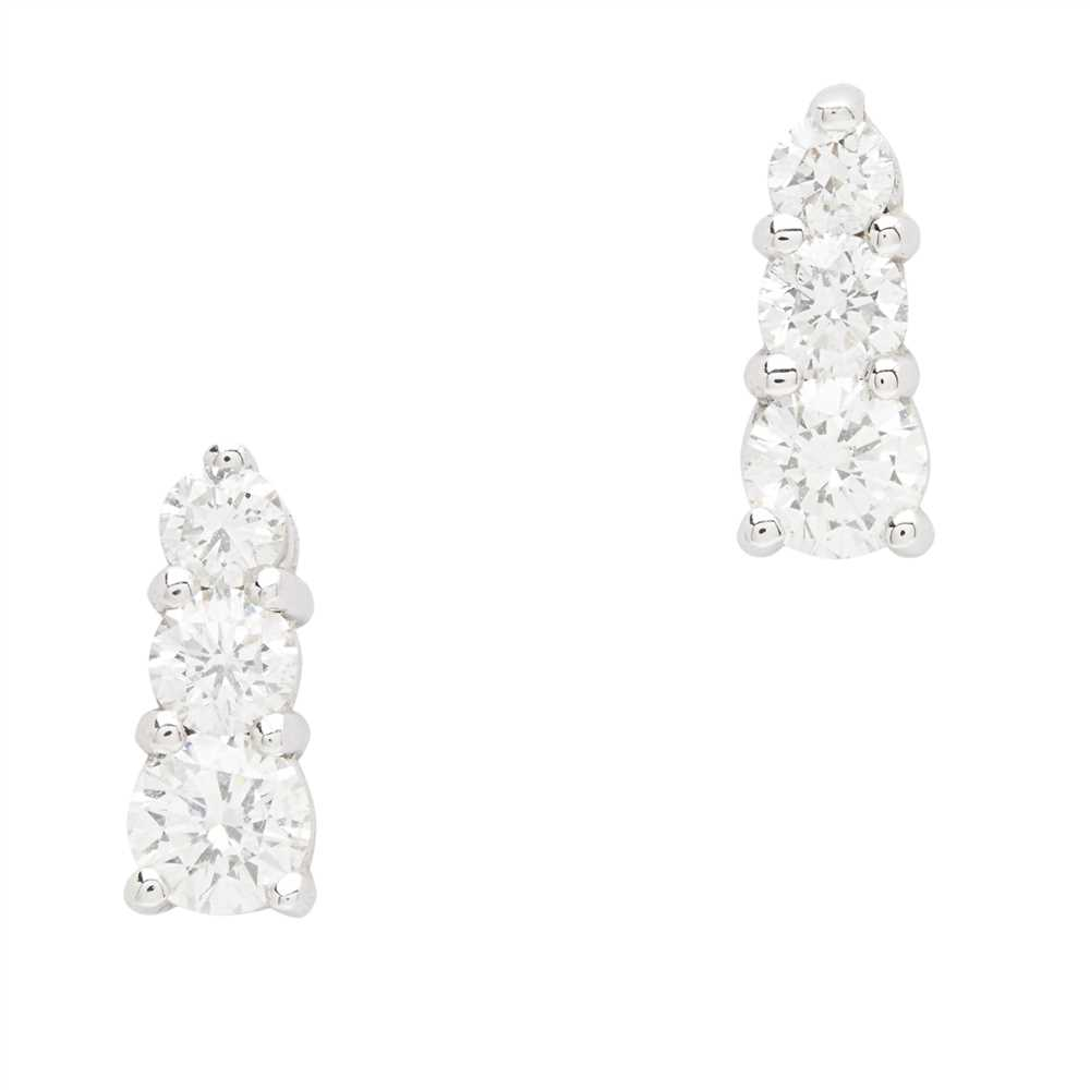 Lot 14-A pair of diamond set earrings