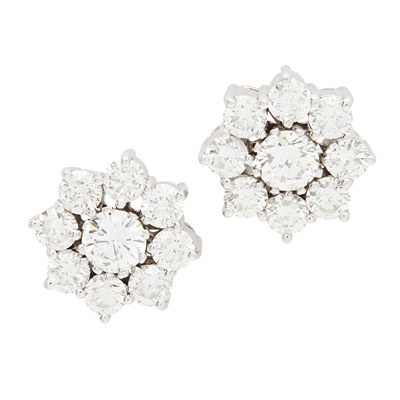 Lot 126 - A pair of diamond cluster earrings